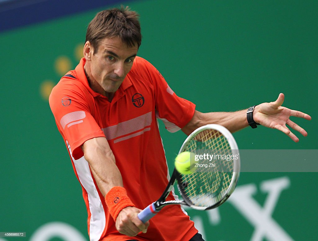Tommy Robredo of Spain returns a shot during his match against Mikhail Kukushkin of Kazakhstan during the day one of the Shanghai Rolex Masters at the Qi Zhong Tennis Center on October 5, 2014 in Shanghai, China.