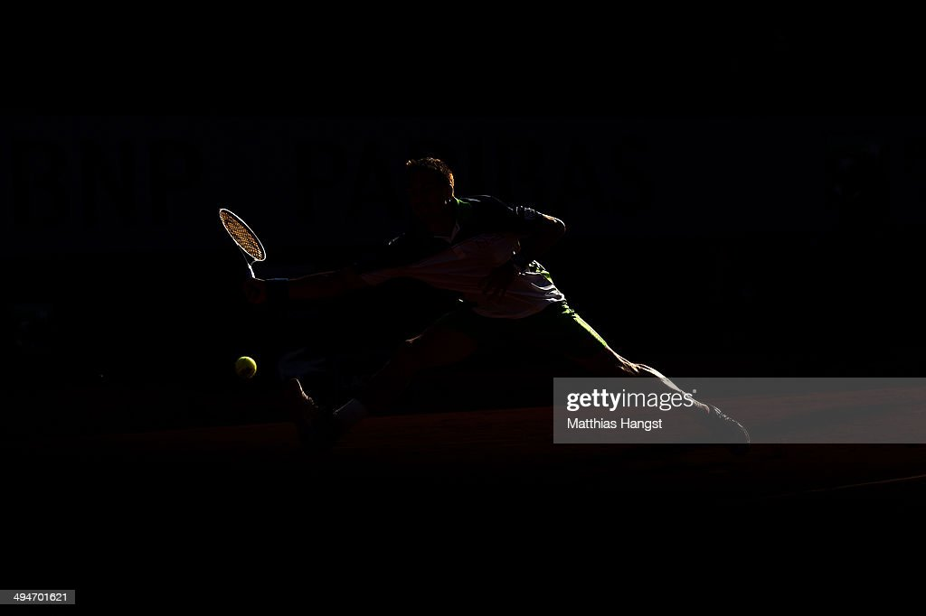 Tommy Robredo of Spain returns a shot during his men's singles match against John Isner of the United States on day six of the French Open at Roland Garros on May 30, 2014 in Paris, France.