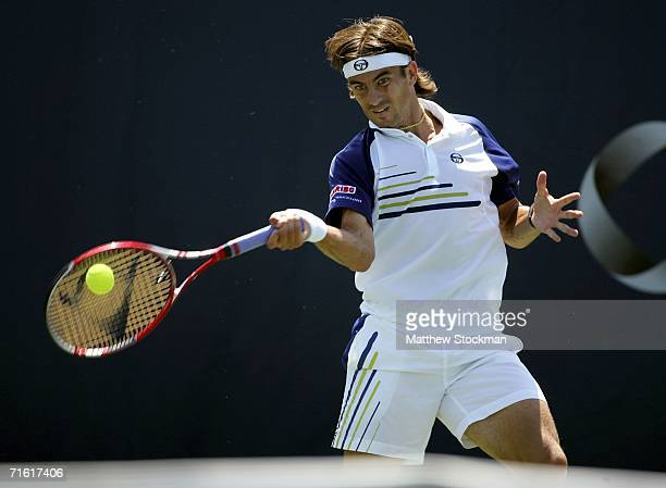 Tommy Robredo of Spain returns a shot to Jose Acasuso of Argentina during the Toronto Masters Series Rogers Cup August 9 2006 in Toronto Canada