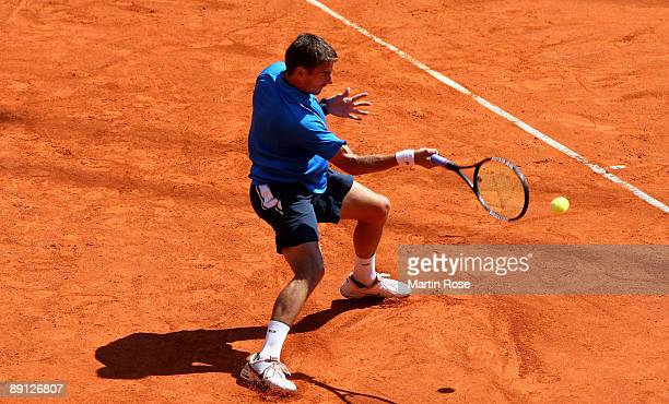 Tommy Robredo of Spain returns the ball during the match against Ivan Navarro of Spain during day two of the International German Open at Rothenbaum...