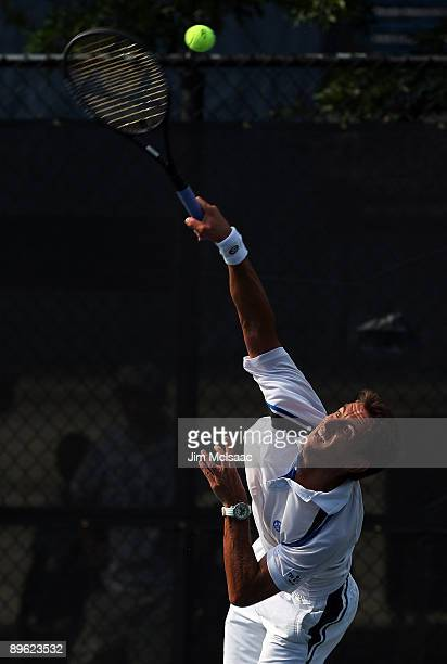 Tommy Robredo of Spain serves to Juan Carlos Ferrero of Spain during Day 3 of the Legg Mason Tennis Classic at the William H.G. FitzGerald Tennis...