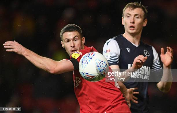 Tommy Rowe of Bristol City is tackled by Jón Daði Böðvarsson of Millwall during the Sky Bet Championship match between Bristol City and Millwall at...