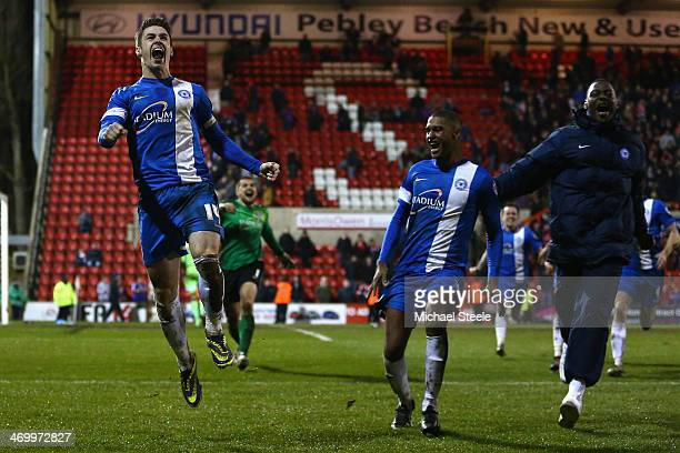 Tommy Rowe of Peterborough United celebrates scoring the winning penalty alngside Britt Assombalonga during the Johnstone's Paint Southern Area Final...