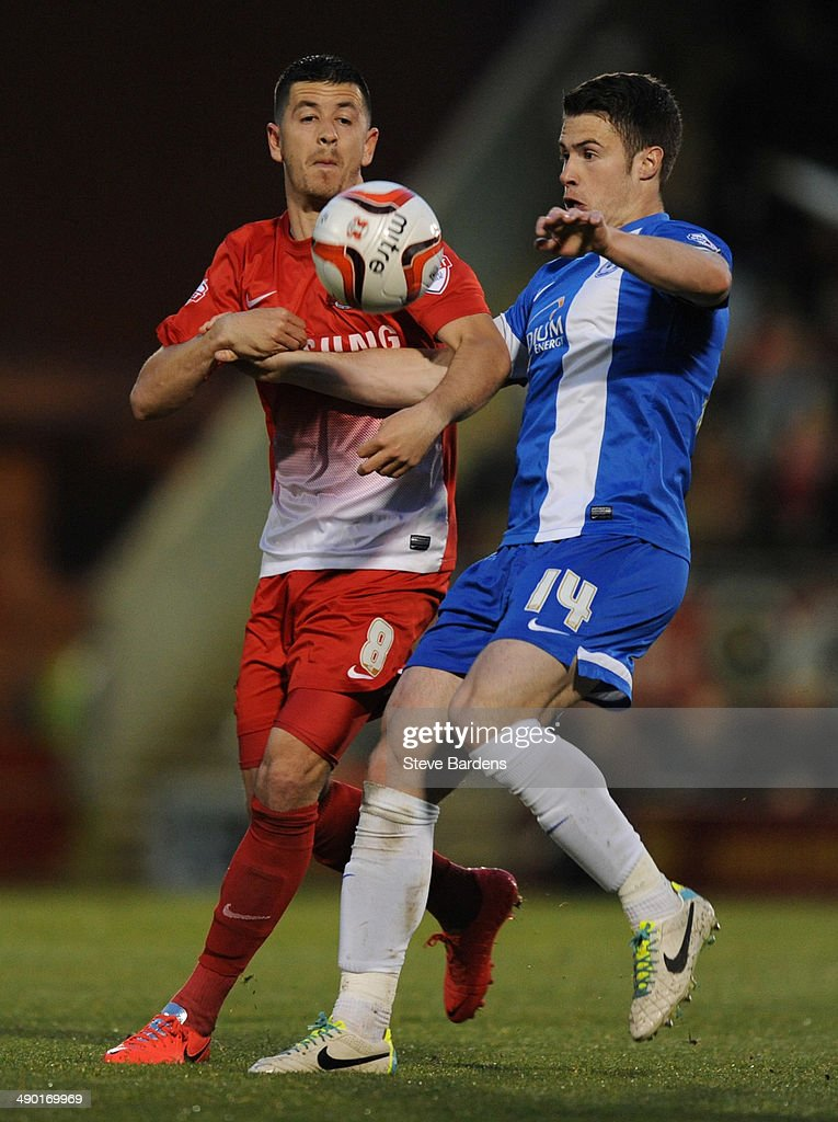 Tommy Rowe of Peterborough United challenges for the ball with Lloyd James of Leyton Orient during the Sky Bet League One play-off semi-final second leg match between Leyton Orient and Peterborough United at Matchroom Stadium on May 13, 2014 in London, England.
