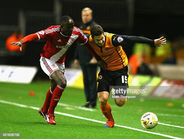 Tommy Rowe of Wolverhampton Wanderers tangles with Albert Adomah of Middlesbrough during the Sky Bet Championship match between Wolverhampton...