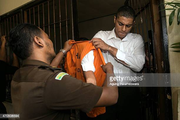 Tommy Schaefer of the United States puts on a prison vest ahead of his verdict hearing on April 21, 2015 in Denpasar, Bali, Indonesia. An Indonesian...