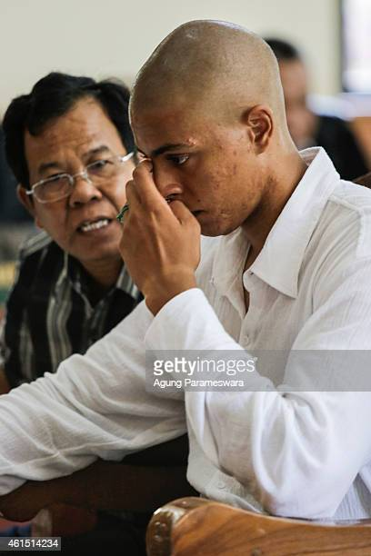 Tommy Schaefer of the US listens to his translator during his first hearing trial in a courtroom on January 14, 2015 in Denpasar, Bali, Indonesia....