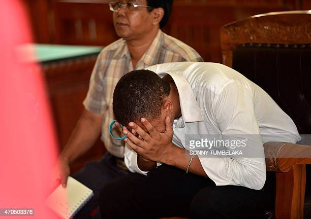 Tommy Schaefer of the US reacts as he listens to the verdict in his murder trial, inside a court room in Denpasar on Indonesia's resort island of...