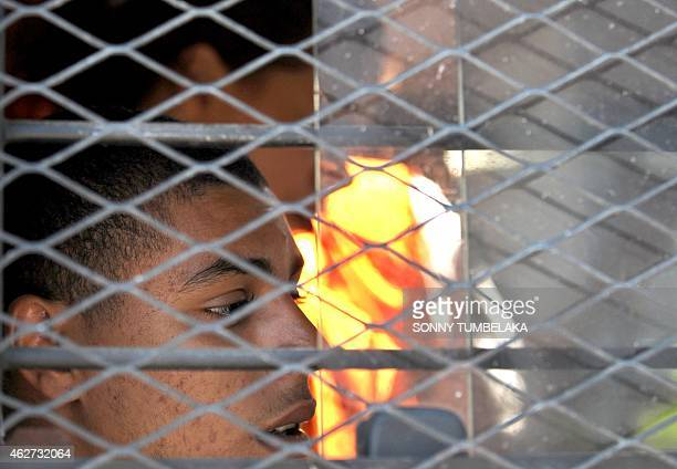 Tommy Schaefer of the US sits inside a prison van at Kerobokan prison in Denpasar on Bali island on February 4, 2015. Schaefer and his teenage...