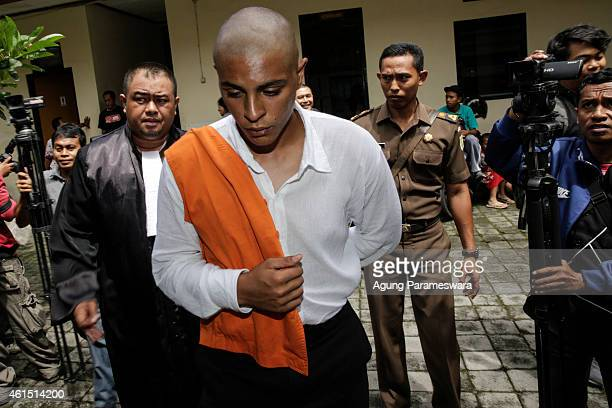 Tommy Schaefer of the US walks to a cell after his first hearing trial on January 14, 2015 in Denpasar, Bali, Indonesia. Tommy Schaefer and his...