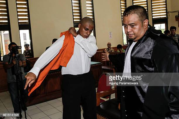Tommy Schaefer of the US wears a prisoner vest after his first hearing trial in a courtroom on January 14, 2015 in Denpasar, Bali, Indonesia. Tommy...