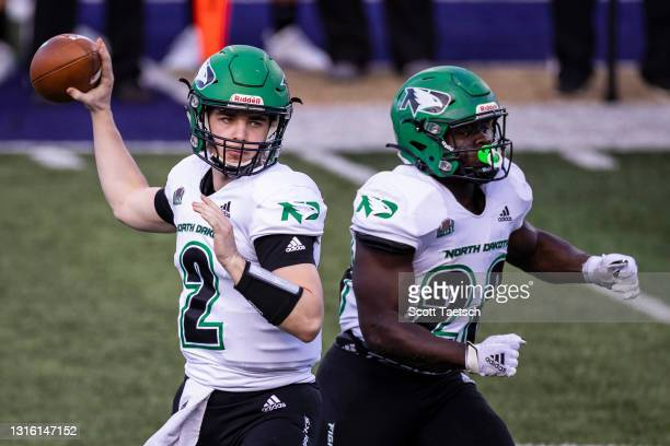 May 02: Tommy Schuster of the North Dakota Fighting Hawks attempts a pass against the James Madison Dukes during the first half of the NCAA Division...