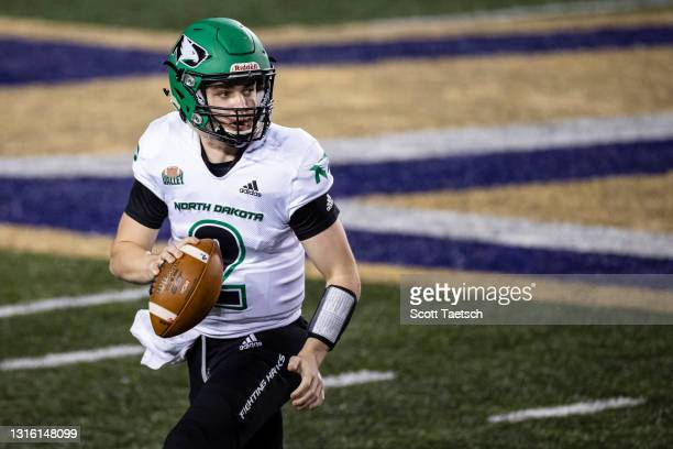 May 02: Tommy Schuster of the North Dakota Fighting Hawks looks to pass against the James Madison Dukes during the second half of the NCAA Division I...
