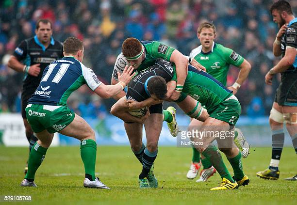 Tommy Seymour of Glasgow tackled by Matt Healy, Sean O'Brien and Bundee Aki of Connacht during the Guinness PRO12 rugby match between Connacht Rugby...