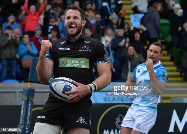 Tommy Seymour of Glasgow Warriors celebrates scoring a try in the second half during the European Rugby Champions Cup match between Glasgow Warriors...