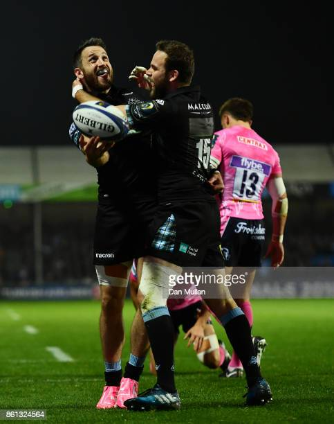 Tommy Seymour of Glasgow Warriors celebrates scoring his side's first try with Ruaridh Jackson of Glasgow Warriors during the European Rugby...