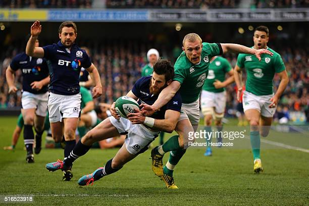 Tommy Seymour of Scotland and Keith Earls of Ireland battle for the ball during the RBS Six Nations match between Ireland and Scotland at the Aviva...