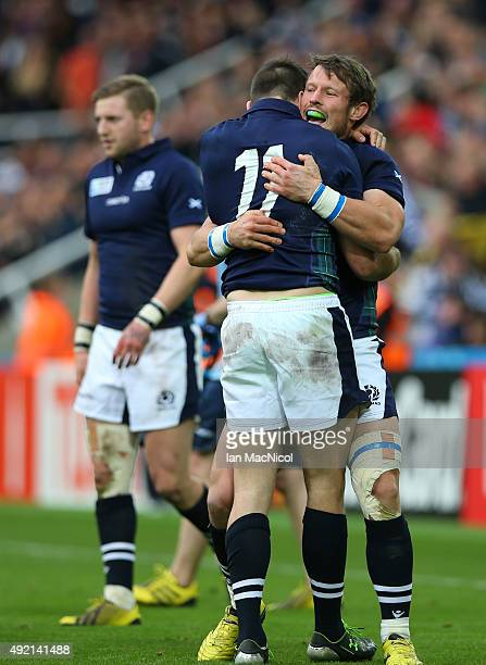 Tommy Seymour of Scotland is hugged by Peter Horne of Scotland at full time during the 2015 Rugby World Cup Pool B match between Samoa and Scotland...