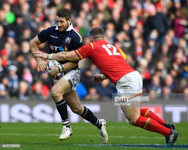 Tommy Seymour of Scotland is tackled by Scott Williams of Wales during the RBS Six Nations match between Scotland and Wales at Murrayfield Stadium on...