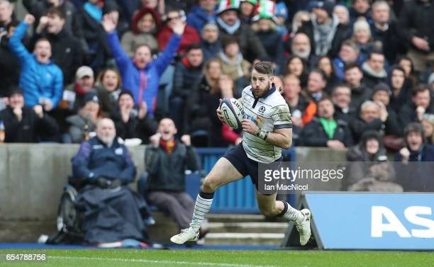 Tommy Seymour of Scotland runs in and scores his teams fourth try during the RBS Six Nations Championship match between Scotland and Italy at...