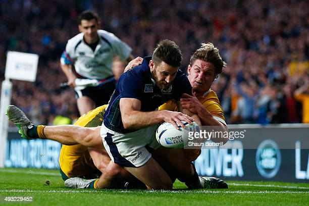 Tommy Seymour of Scotland scores his team's second try tackled by Michael Hooper of Australia during the 2015 Rugby World Cup Quarter Final match...