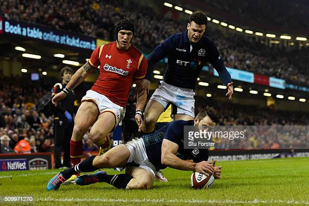 Tommy Seymour of Scotland touches down from a cross kick to score his team's first try during the RBS Six Nations match between Wales and Scotland at...