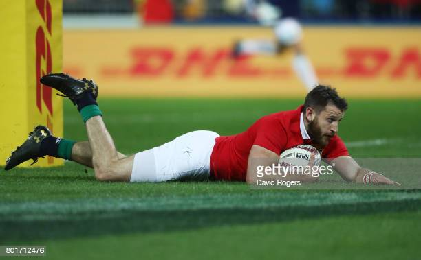 Tommy Seymour of the Lions dives over to score the opening try during the 2017 British Irish Lions tour match between the Hurricanes and the British...