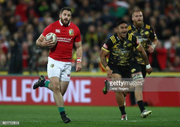 Tommy Seymour of the Lions runs in the opening try during the 2017 British Irish Lions tour match between the Hurricanes and the British Irish Lions...