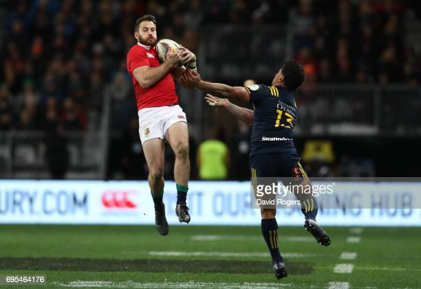 Tommy Seymour of the Lions takes a high ball meant for Malakai Fekitoa of the Highlanders leading to Seymour scoring his team's second try during the...