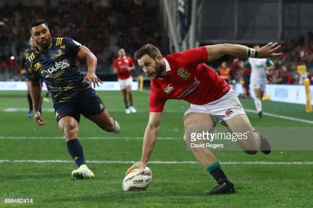 Tommy Seymour of the Lions touches down to score his team's second try during the 2017 British Irish Lions tour match between the Highlanders and the...