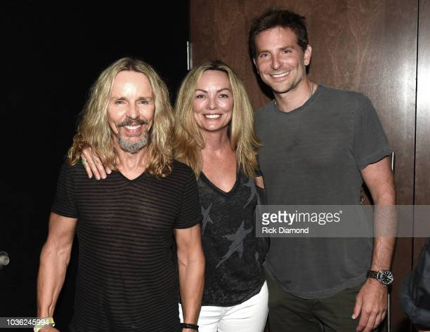 "Tommy Shaw of the band STYX, Jeanne Mason-Shaw and Actor/Director Bradley Cooper attend ""A Star Is Born"" screening with Bradley Cooper and Lukas..."