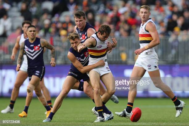 Tommy Sheridan of the Dockers and Richard Douglas of the Crows contest for the ball during the round 12 AFL match between the Fremantle Dockers and...