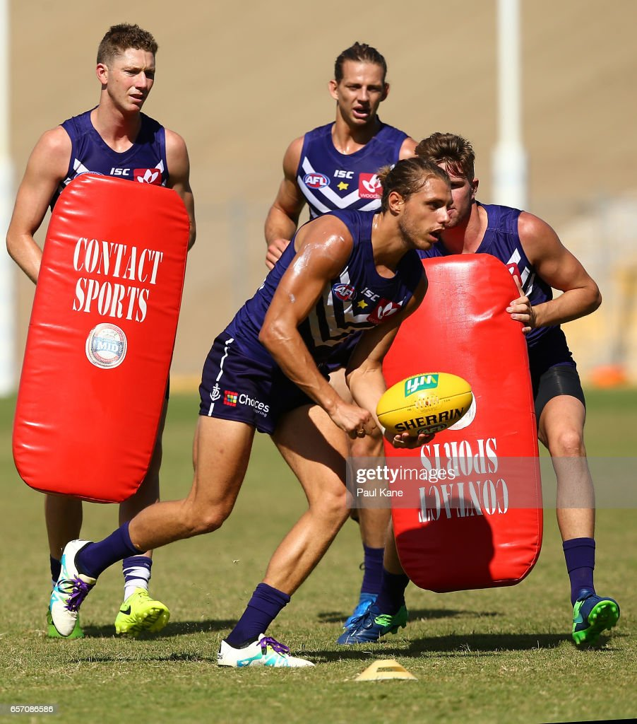 Tommy Sheridan of the Dockers works on a tackling drill during a Fremantle Dockers AFL training session at Victor George Kailis Oval on March 24, 2017 in Perth, Australia.