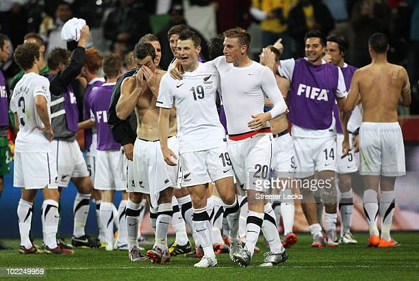 Tommy Smith and Chris Wood of New Zealand celebrate with team mates after a draw in the 2010 FIFA World Cup South Africa Group F match between Italy...