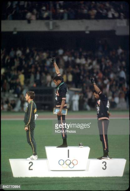 """Tommy Smith and John Carlos of the US raise their fists in the """"Black Power Salute"""" during the playing of the national anthem at the Olympics in..."""