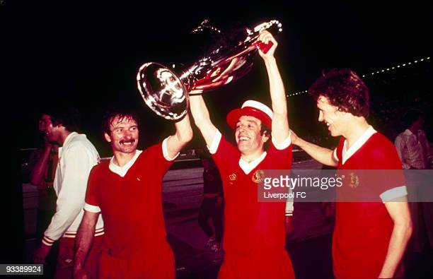 Tommy Smith, Ian Callaghan and Phil Neal of Liverpool parade the trophy after the 1977 European Cup Final between Liverpool and Borussia...