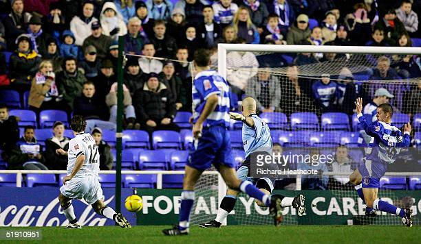 Tommy Smith of Derby scores the first goal during the FA CocaCola Championship match between Reading and Derby County held at the Madejski Stadium on...