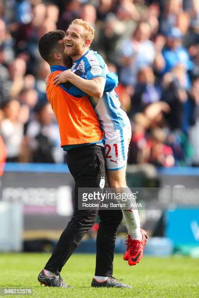Tommy Smith of Huddersfield Town and Alex Pritchard of Huddersfield Town celebrate at full time during the Premier League match between Huddersfield...