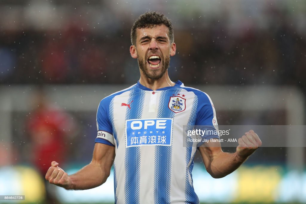 Tommy Smith of Huddersfield Town celebrates at full time during the Premier League match between Huddersfield Town and Manchester United at John Smith's Stadium on October 21, 2017 in Huddersfield, England.