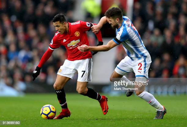 Tommy Smith of Huddersfield Town chases down Alexis Sanchez of Manchester United during the Premier League match between Manchester United and...
