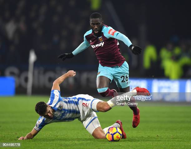 Tommy Smith of Huddersfield Town is fouled by Arthur Masuaku of West Ham United during the Premier League match between Huddersfield Town and West...