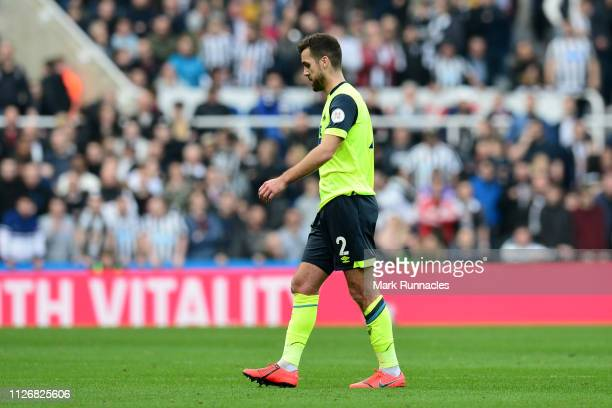 Tommy Smith of Huddersfield Town walks off the pitch after receiving a red card during the Premier League match between Newcastle United and...