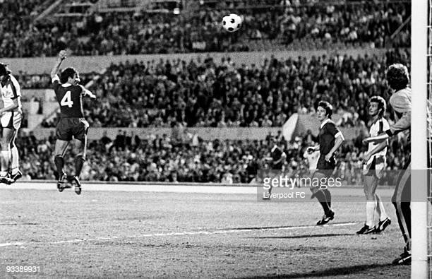 Tommy Smith of Liverpool leaps above the defence to power home his header to score the second goal and help Liverpool regain the lead during the 1977...