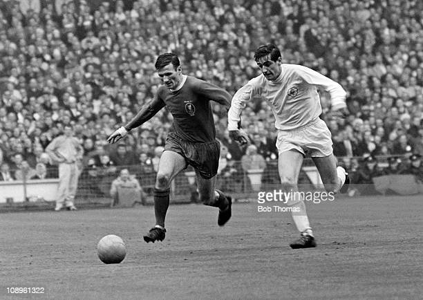 Tommy Smith of Liverpool with Norman Hunter of Leeds United during the Liverpool v Leeds United FA Cup Final held at Wembley Stadium London on the...