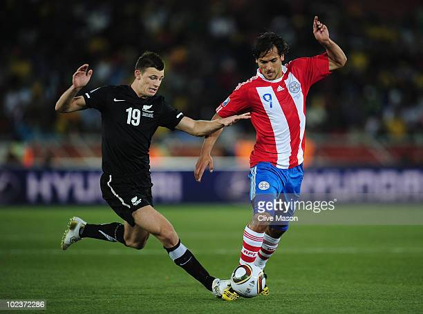 Tommy Smith of New Zealand and Roque Santa Cruz of Paraguay battle for the ball during the 2010 FIFA World Cup South Africa Group F match between...