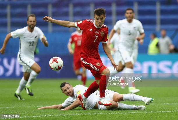 Tommy Smith of New Zealand tackles Dmitry Poloz of Russia during the FIFA Confederations Cup Russia 2017 Group A match between Russia and New Zealand...