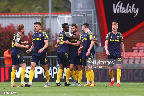 Tommy Smith of Stoke City celebrates with John Obi Mikel and team mates after scoring their side's second goal during the Sky Bet Championship match...