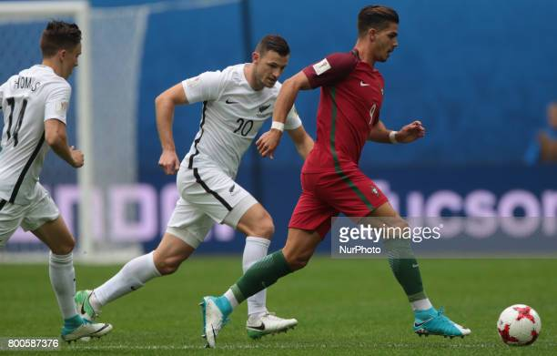 Tommy Smith of the New Zealand national football team and André Silva of the Portugal national football team vie for the ball during the 2017 FIFA...