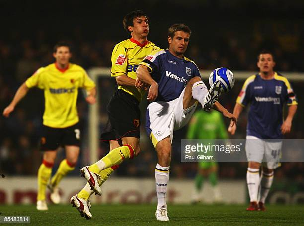 Tommy Smith of Watford battles for the ball with Stephen McPhail of Cardiff City during the Coca-Cola Championship match between Cardiff City and...