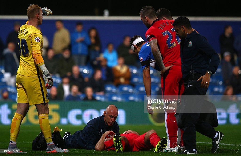 Tommy Spurr of Blackburn gets treatment after a head injury during the Sky Bet Championship match between Queens Park Rangers and Blackburn Rangers at Loftus Road on September 16, 2015 in London, England.